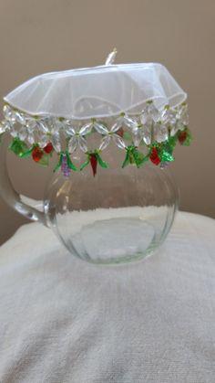 Cobre jarra de fruta, com 20cm de diâmetro, feito em tulê.  Lindo para deixar sua mesa decorada para receber amigos e familiares, além de proteger contra insetos.