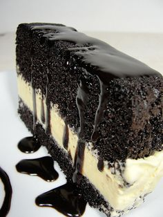 perfect ice cream cake...moist rich chocolate cake, vanilla ice cream, chocolate cookie crust, and chocolate drizzle