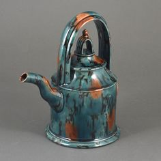 WALTER KEELER (British, b.1942) AR Teapot, circa 1999 Earthenware, green and orange Whieldon style glaze, with looping handle and finial,  impressed maker's mark