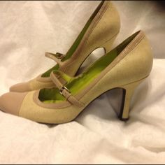 """☀️Kenneth Cole Pebbled Cap Toe Pumps☀️ Pebble-textured cap toe pumps by Kenneth Cole Reaction.  Creamy-taupe contrasting toe caps, buckle straps and trim.  Flourescent green footbeds.  Gently worn:  two tiny scratches on the right toe and a little one on the back right heel.  The insoles have seen a little action--priced accordingly.  2.75""""ish heels. Kenneth Cole Shoes Heels"""