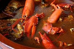 Lobster Stew - a Minorcan dish. The lobster is added to a sofrito, onions, tomatoes, garlic and parsley and boiled, and is eaten with thin slices of bread. It is one of the most famous dishes in Minorca, Balearic Islands.