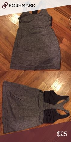 Lululemon gray tank Lululemon tank, gray, size 4, built in support, perfect condition. It's a little longer than most lulu tanks so would be great for someone taller. lululemon athletica Tops Tank Tops