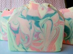 Twisted Citrus is a cold processed soap with citrus colored swirls of pink for grapefruit, orange, green for lime and lemongrass, yellow for lemon and yuzu. It smells awesome and contains: cream, buttermilk powder, shea butter and silk.