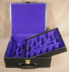 This black vinyl chess piece storage box features 2 trays with slots for chess pieces up to a 4 inch king with a inch base. It's a great box for your most valuable pieces. Chess Pieces, Game Pieces, Popular Family Board Games, Fun Games, Games To Play, Luxury Chess Sets, Chess Boxing, Game Resources, Classic Board Games