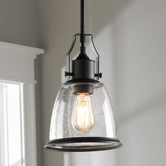 "This industrial-inspired pendant has a classic shaped bell shade that will complement any decor. The top pivot adds authenticity and the clear seeded glass meets any design objective. Add an antique-style incandescent bulb for vintage appeal. (11.75""Hx7.5""W)1-75W max, medium base socket.Total Height: up to 56 3/8''(3) 12"" and (1) 6"" rods provided.Supplied with 180'' of wire.5"" canopy with swivel."