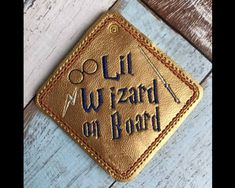 Lil Wizard on Board Car SignThis Adorable hanging car window sign sews in the 4x4 hoop on any colored vinyl.This items is made to hang by suction cup in any car window - it can be hung by either one or two suction cups, whichever works best.Available Formats Include - DST, PES, PEC, HUS, JEF, VIP, VP3, and EXPYou may make this design as many times as you like, and you may sell your finished car signs, however, please do not modify, share or resell my original digital design.Thanks so much…