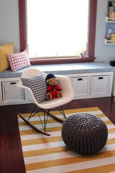baby boy nursery in Seattle. love the ikea bookshelf upholstered and turned into a window seat with basket drawer storage! so cool!