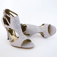A fashionable twist to the evening sandal. A starburst of clear & AB crystals adorn the center of the shoe. Designed by Benjamin Adams, The Madrid in Silver. Designer Wedding Shoes, Crystal Cocktail Party Shoes $350
