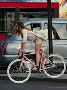 Girl on a pink bicycle