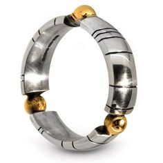 Simple and stunning contemporary silver with gold detail handmade ring by Nikki Galloway.