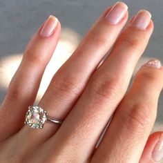 Just a solitaire diamond with a thin dainty band in a 6 prong setting is PERFECTION