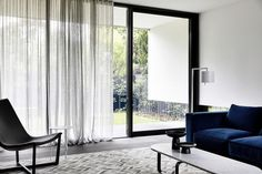 Sheer S-Fold curtains adding softness to the living space in Manor House project. Product: S-Fold Curtain Fabric: Sheer Joe Silver by . Cheap Curtains, Curtains With Blinds, Curtains Living, Black Sheer Curtains, Home Living Room, Living Spaces, Unique Window Treatments, House Blinds, Interior Windows