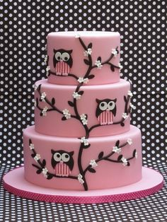 Substitute lavender, white, and blue for the pink and make tree branch white with snow and snowflakes around the cake and the owl be purple and white