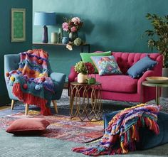 Love everything about this room. Wall color, choice of textiles.
