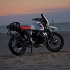 Former Paris-Daker racer Fabio Marcaccini now runs Unit Garage, and he's put his experience to good use with a long-distance kit for the BMW R nineT. Bike Bmw, Bmw Motorcycles, Custom Motorcycles, Bmw Scrambler, Nine T, R80, Travel Around The World, Used Cars, The Unit