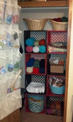 Craft closet organized with milk crates and shoe organizer