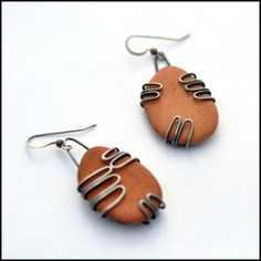 Terra cotta beach pottery shards tumbled by the sea are set into sterling silver, creating a unique handcrafted pair of earrings by artisan jewelry designer Erin Austin. The terra cotta pottery shards Wire Wrapped Earrings, Wire Earrings, Wire Crafts, Jewelry Crafts, Jewelry Ideas, Metal Jewelry, Custom Jewelry, Jewlery, Unique Jewelry