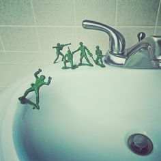 Brock Davis - At ease, soldier. My son asked me why his army men are on standing on skateboards. So we made this scene for fun. Cut the rifle out of this soldier's hands, glued rocket launcher pieces to make the wheels and glued him to the sink.