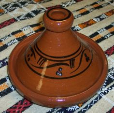 Moroccan Wave Cooking Tagine By Treasures of Morocco by Hand Made. $29.99. Measurement:9.5 inches wide (at base). Your food stays moist and taste delicious. Cook Chicken, Meat, Seafood or Vegeterian food. Importand from Moroccan.  Free Shipping. Ideal for cooking on top of any kind of stove. Simple and functional, this authentic, handcrafted Moroccan cooking Tagine is ready to be used for your next flavorful and exotic Moroccan meal.The Tagine is to be use on the top...
