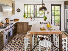 This #kitchen with Cuban-style title flooring is unique in every way #hgtvmagazine http://www.hgtv.com/kitchens/how-i-met-my-mother-in-law/pictures/page-4.html?soc=pinterest