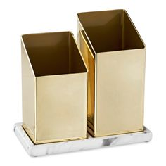 Bring some chic appeal and handy convenience to your bathroom with the Nate Berkus Angled Brass Brush Holder. Made of durable iron with a sleek brass finish, it comes with a striking and sturdy ceramic base. With bright style and the signature Nate Berkus flair, it brightens up any countertop while holding hair brushes, toothbrushes and much more.