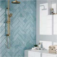 Loving this stunning herringbone blue tile!   #herringbone #tile #bathroom #decor #homedecor #gold #minimalist