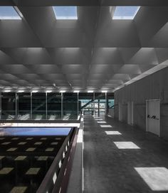Image 6 of 115 from gallery of Museu dos Coches / Paulo Mendes da Rocha + MMBB Arquitetos + Bak Gordon Arquitectos. Photograph by Fernando Guerra Stone Pavement, Corridor Lighting, Glazed Walls, City Pass, Ceiling Treatments, New Museum, Luz Natural, Ground Floor, Landscape Architecture