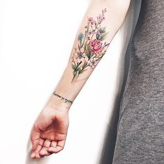 I love this floral tattoo. with tattoos I love this floral tattoo. with tattoos Nature Tattoo Sleeve, Nature Tattoos, Body Art Tattoos, Sleeve Tattoos, Tatoos, Rib Tattoos, Girl Arm Tattoos, Color Tattoos, Tattoo Sleeves