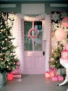 If the color pink is already a favorite at your house, it's easy to add holiday touches to match. The pink painted trim on this front porch makes the perfect backdrop for pink packages, a pink door wreath, and pink glass jar luminaries. Additions of white paper snowflakes and garland keep the frilly color scheme from going overboard.
