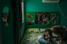 March 9, 2016 MAURICIO LIMA FOR THE NEW YORK TIMES Germana Soares, 24, with her son, Guilherme. She contracted the Zika virus while pregnant, and Guilherme has microcephaly.