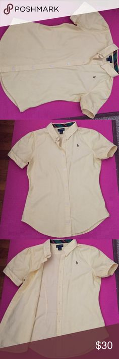 Yellow Ralph Lauren oxford shirt Yellow Ralph Lauren oxford shirt in size 16 or kids XL. Clean and comes from smoke free home. Missing top button but has additional button at the bottom, can fit a women's size 0-4 Ralph Lauren Tops Button Down Shirts