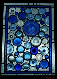 Recycled glass art - this would be a cool way to create a stained-glass interior window. To make it doable for me, just use the round parts and don't bother with filling in between them with custom cut glass shapes Stained Glass Projects, Stained Glass Art, Stained Glass Windows, Mosaic Art, Mosaic Glass, Fused Glass, Cobalt Glass, Cobalt Blue, Mosaic Mirrors