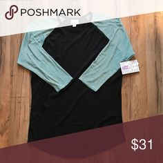 Medium mint and black Lularoe Randy Shirt So cute. Super soft. Stretchy material. Size Medium. Brand new with tags. LuLaRoe Tops