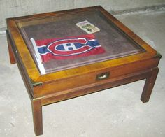 Campaign style wood coffee table display case. Vintage, likely '70s. On Kijiji Montreal.
