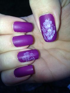 Purple and white nail stamping