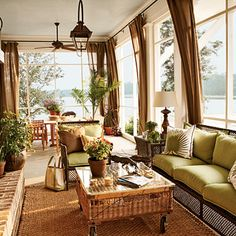 All window sunroom with curtains makes it look even taller. Nice colors like plantation style in Hawaii