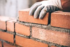 Close up of industrial bricklayer installing bricks on construction site by stockcentral. Close up of industrial bricklayer installing bricks on construction site Lorraine, Brick Calculator, Building A Brick Wall, House Building, Building Ideas, Last Will And Testament, Working Holidays, Brick And Mortar, Cement