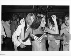 Entertainers and celebrity couple Gregg Allman and Cher attend a party in honor of the Doobie Brothers on May 2, 1975 in Los Angeles, California.