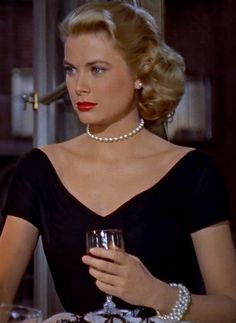 "Grace Kelly as 'Lisa Carol Fremont' in ""Rear Window"" (1954)"