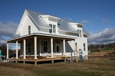Modern Farmhouse in Vermont with Insulated Concrete Forms for basement, standing seam metal roof, radiant heat floors and other green aspects of building.