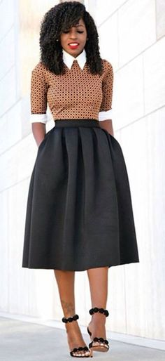 I love the 'formality' of the collared top with a modest, waist-hugging skirt. -C