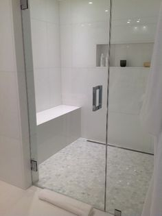 Calacatta Marble Hexagon Mosaic Shower Floor and White Marble on Bathroom Walls
