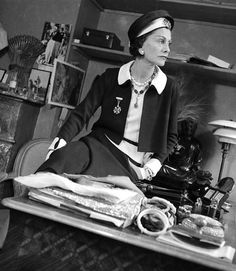 Coco Chanel on her desk wearing her own design, photo by François Kollar, 1938