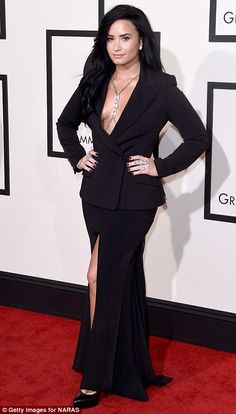 Grown-up glamour: Demi Lovato went for elegant sophistication in a plunging black gown with lots of silver jewellery
