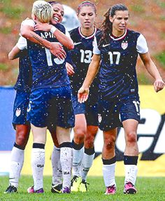 Wet soccer players!  Tobin Heath, Megan Rapinoe and baby horse!