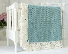 PDF PATTERN of how to make the Claire Baby Blanket. NOT A PHYSICAL BLANKET FOR SALE.  ♥ Crochet pattern for the simply elegant Claire baby blanket with intricate edging. It will be a hit as a baby shower gift for new moms, or an heirloom within the family.  ♥ Pattern provided makes a blanket approximately 33 X 33 inches, crocheted with specified yarn and gauge. ♥ Use any DK weight yarn.  ♥ This pattern is written in standard US TERMS and includes helpful photos.  ♥ Skill level - Beginner to…