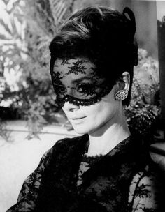 "Audrey wearing Givenchy's black lace dress in a scene from the film ""How to Steal a Million."""