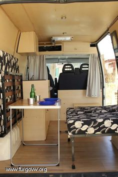 2 flip up beds, fold up table, storage over cab, reflectix cover for fantastic fan.  If only front seats turned.  (fiat ducato)