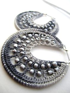 Beautiful photography of these gray crochet stitches and metals.