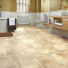 Durable, waterproof Karndean bathroom flooring! 🛀 The light buttery tones of our Jersey Island Limestone have a gentle tumbled surface texture and soft dapple pattern. Each panel is created using a variety of tile sizes to recreate the random pattern effect of a traditional limestone. Order your #free sample today! Waterproof Bathroom Flooring, Vinyl Flooring Bathroom, Luxury Vinyl Tile Flooring, Bathroom Vinyl, Vinyl Tiles, Wood Vinyl, Bathroom Floor Tiles, Kitchen Flooring, Bathroom Ideas